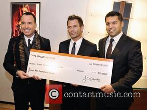 David Furnish, Michael King and Karim Karsan