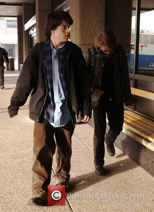 Macaulay Culkin and a male friend arriving at Salt Lake City Airport for the 2009 Sundance Film Festival, Day 3...