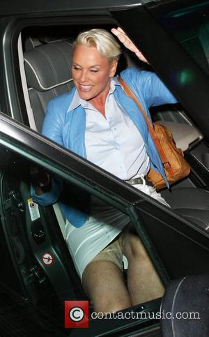 Brigitte Nielsen reveals her Spanx (support underwear) as she gets into her car while leaving Madeo restaurant where she had...