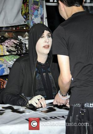Marilyn Manson signs copies of his new album 'The High End of Low' at Hot Topic Hollywood Los Angeles, California...