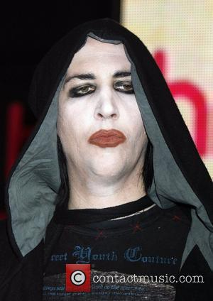 Marilyn Manson signs copies of his new album 'The High End Of Low' at HMV Oxford Circus London, England -...