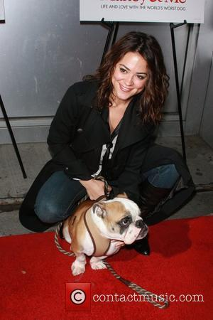 Camille Guaty and her dog Boss New York Premiere of 'Marley & Me' at Tribeca Cinemas Gallery - arrivals New...
