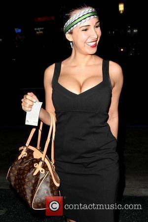 Mayra Veronica Cuban model arriving at Katsuya restaurant wearing a green headband Los Angeles, California - 11.05.09