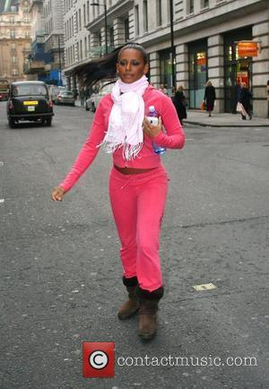Melanie Brown wearing a pink tracksuit on her way to a restaurant during a break from promoting her new fitness...