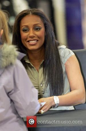 Melanie Brown signs autographs for fans while promoting her new DVD fitness video 'Totally Fit' at the Lakeside centre Tesco...