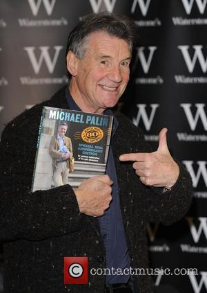 Michael Palin signs copies of his book 'Around The World In 80 Days... 20th Anniversary Edition' at Waterstone's, Piccadilly London,...