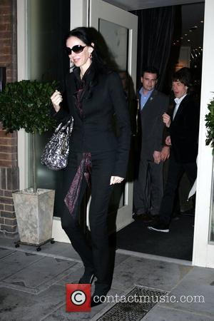L'Wren Scott and Mick Jagger leaving La Petite Maison restaurant after having lunch with other members of The Rolling Stones...