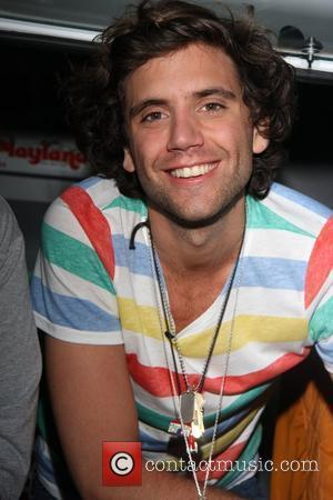Mika Gossip blogger Perez Hilton and British singer Mika promote Mika's April 15 free concert at the Roxy by handing...