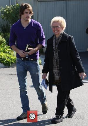 Justin Gaston visits church with the Cyrus family Los Angeles, California - 04.01.09