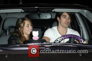 Miley Cyrus and boyfriend Justin Gaston leaving Koi restaurant in West Hollywood Los Angeles, California - 31.03.09
