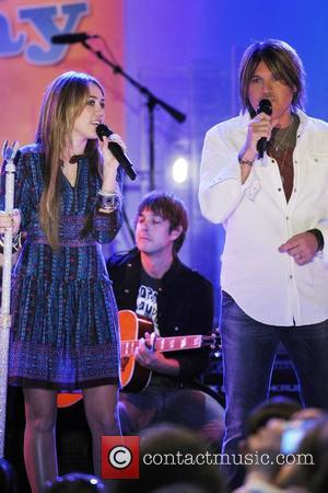Miley Cyrus and Billy Ray Cyrus