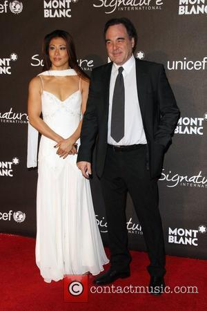 Oliver Stone and his wife Sun-jung Jung The Montblanc Signature for Good Charity Gala held at the Paramount studios -...