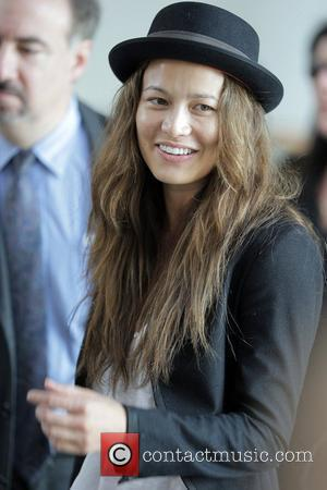 'Terminator Salvation' co-star Moon Bloodgood and friend walk through the airport security checkpoint to catch an America Airlines flight Los...