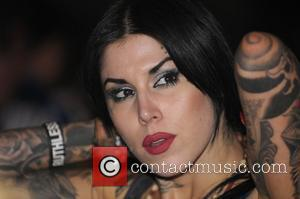 Kat Von D watches her boyfriend Nikki Sixx of Motley Crue perform at Hard Rock Live at the Seminole Hard...