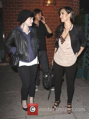 Kelly Osbourne and Kim Kardashian