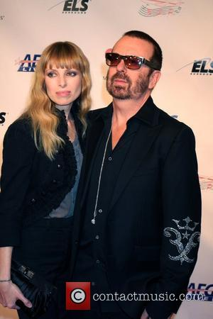 Dave Stewart and guest Music Cares man of the year dinner honoring Neil Diamond at the Los Angeles convention center...