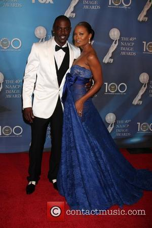 Lance Gross and Eva Marcille  40th NAACP Image Awards held at the Shrine Auditorium - Arrivals Los Angeles, California...