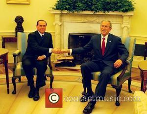 George W. Bush and Italian Prime Minister Silvio Berlusconi meet after giving a joint statement in the Rose Garden of...