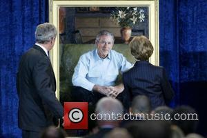 US President George W. Bush and First Lady Laura Bush unveil their portraits at the Smithsonian National Portrait Gallery Washington...