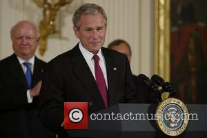 US President George W Bush signs H.R. 7081, the United States-India Nuclear Cooperation Approval and Nonproliferation Enhancement Act, at the...