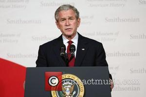 US President George W Bush President George W. Bush attends the reopening of the Smithsonian National Museum of American History...