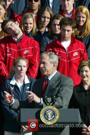 President George W. Bush and First Lady Laura Bush greet US Olympians on the South Lawn of the White House...