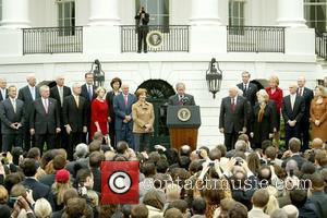 First Lady Laura Bush, President George W. Bush and Vice President Dick Cheney President George W. Bush addressed his staff...