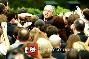 President George W. Bush addressed his staff and administration on the South Lawn of the White House stating that he...