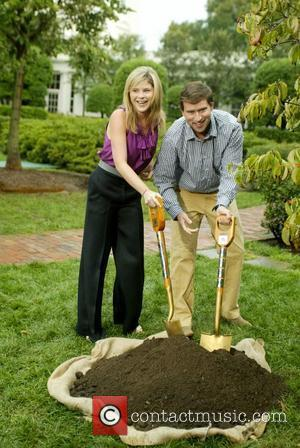 Jenna Bush Hager and her husband, Henry Hager hold shovels as they participate in a commemorative tree planting on the...