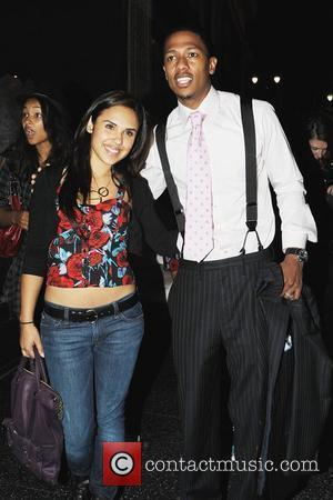 Nick Cannon and Kristina DeBarge pose for pictures outside Katsuya in Hollywood Los Angeles, California - 23.04.09