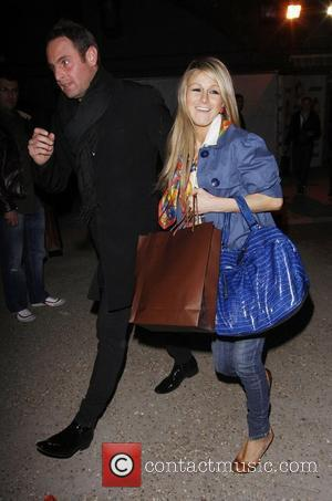 Nikki Grahame and a Male Companion No Nuts! No Entry!' party held at The Arches - Departures London, England -...