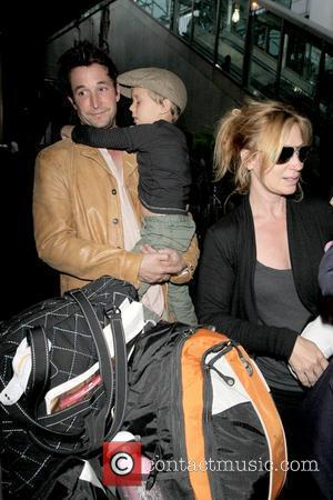 Noah Wyle, Owen Wyle and Tracy Warbin Noah Wyle and family arriving at LAX  Los Angeles, California - 29.04.09