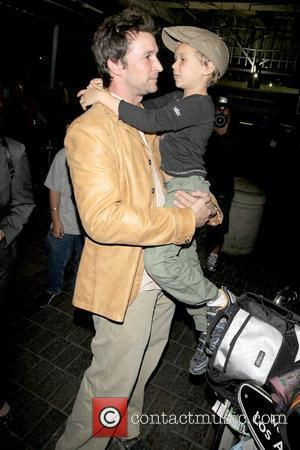 Noah Wyle and Owen Wyle Noah Wyle and family arriving at LAX  Los Angeles, California - 29.04.09