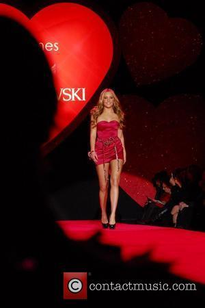 Amanda Bynes wearing Daniel Swarovski Mercedes-Benz IMG New York Fashion Week Fall 2009 - The Heart Truth's Red Dress Collection...