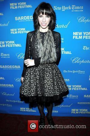 Sally Hawkins, with her arm in a sling after breaking her collar bone at the Premiere of 'Happy Go Lucky'...