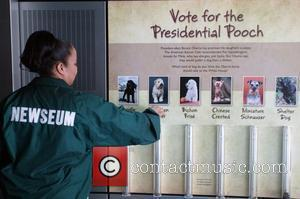 The Newseum is polling guests asking them to vote with coins which dog president elect obama should choose for his...