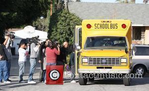 Ed Doud, father of Nadya Suleman who gave birth to octuplets, takes his grandson into a school bus Los Angeles,...