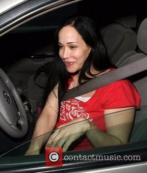 'Octomom' aka Nadya Suleman spotted getting a coffee at Starbucks on her way home, after spending 5 hours at hospital...