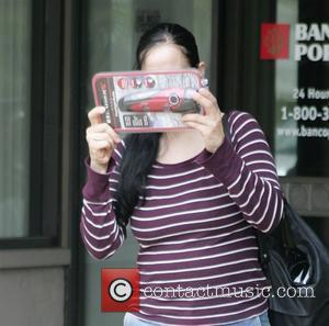 Nadya Suleman, aka Octomom, checks out a Weather X Radio/Flashlight as she leaves a bank Los Angeles, California - 11.03.09