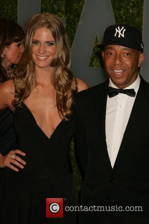 Russell Simmons and guest The 81st Annual Academy Awards (Oscars) - Vanity Fair Party Hollywood, California - 22.02.09