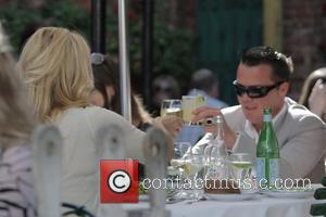 Pamela Anderson and A Male Friend Have Lunch At The Ivy