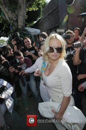 Pamela Anderson and A Male Friend Leave The Ivy After Having Lunch