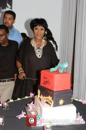 Patti LaBelle prepares to cut her Christian Louboutin cake as she celebrates her 65th Birthday at KeVen Parker's Miss Tootsie's...