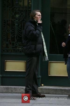 Paul Dano has a cigarette while out and about in Manhattan New York City, USA - 24.02.09