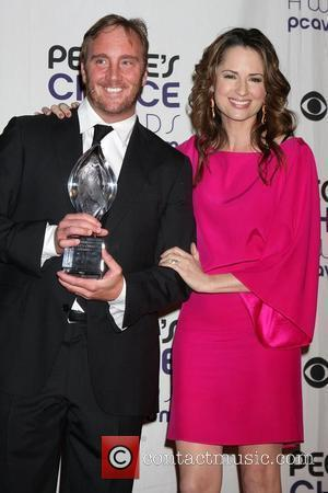 Jay Mohr and Paula Marshall 35th Annual People's Choice Awards at the Shrine Auditorium - Press Room Los Angeles, California...