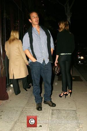 Peter Berg waiting for his car valet as he leaves El Sole Restaurant. Los Angeles, California - 09.04.09