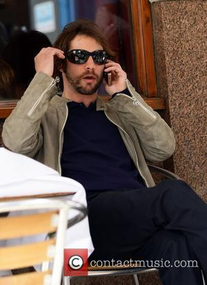 Jason Kay aka J.K. Of Jamiroquai sits outside a cafe on the Portobello road London, England - 08.05.