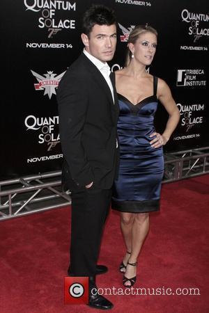 Aidan Turner and James Bond