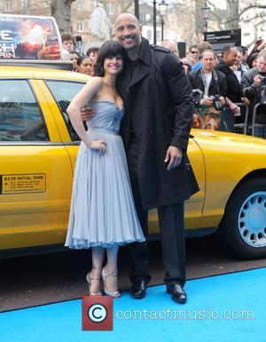Dwayne Johnson and Carla Gugino