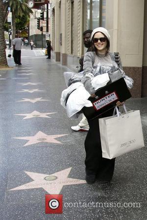 Rachel Bilson carrying large Jimmy Choo shopping bags in Hollywood Los Angeles, California - 15.04.09
